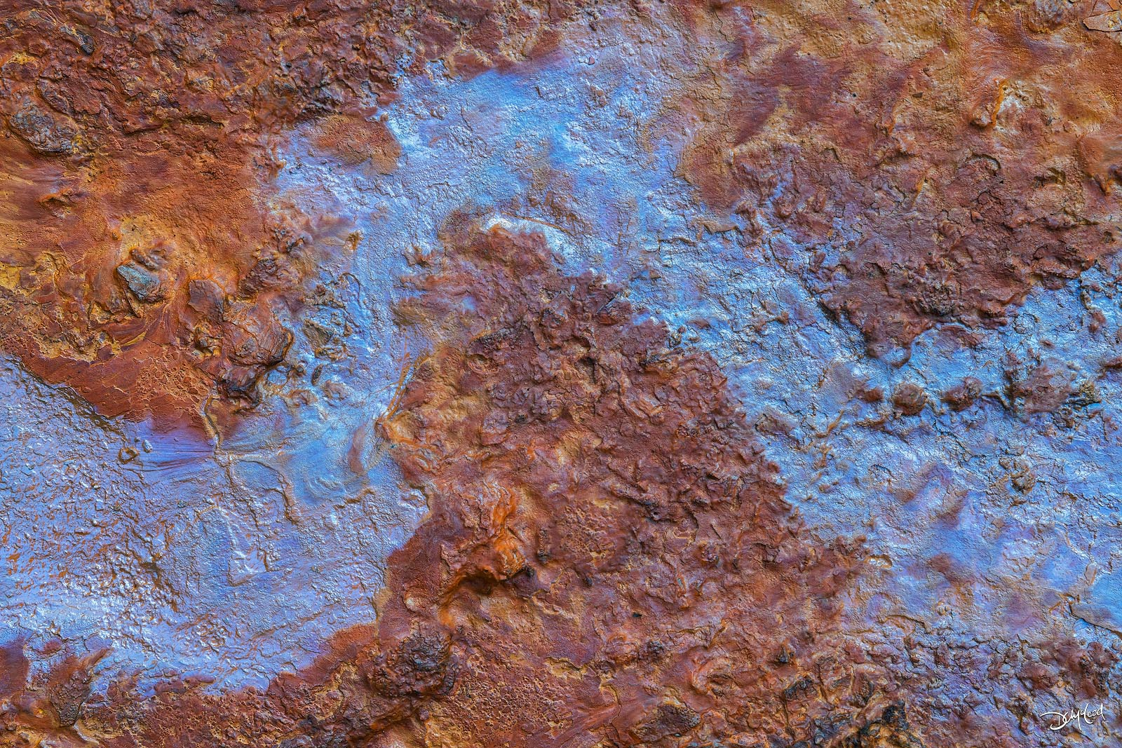 Mineral rich wet soil with brown and blue coloring at the Paint Pots, Kootenay National Park, British Columbia, Canada.
