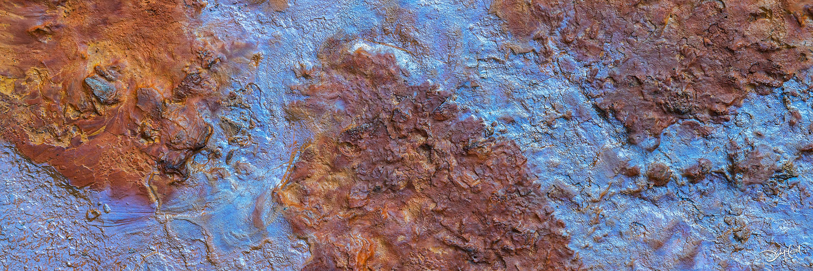 Brown and blue colors in mineral rich wet soil at the Paint Pots, Kootenay NP, BC, Canada.