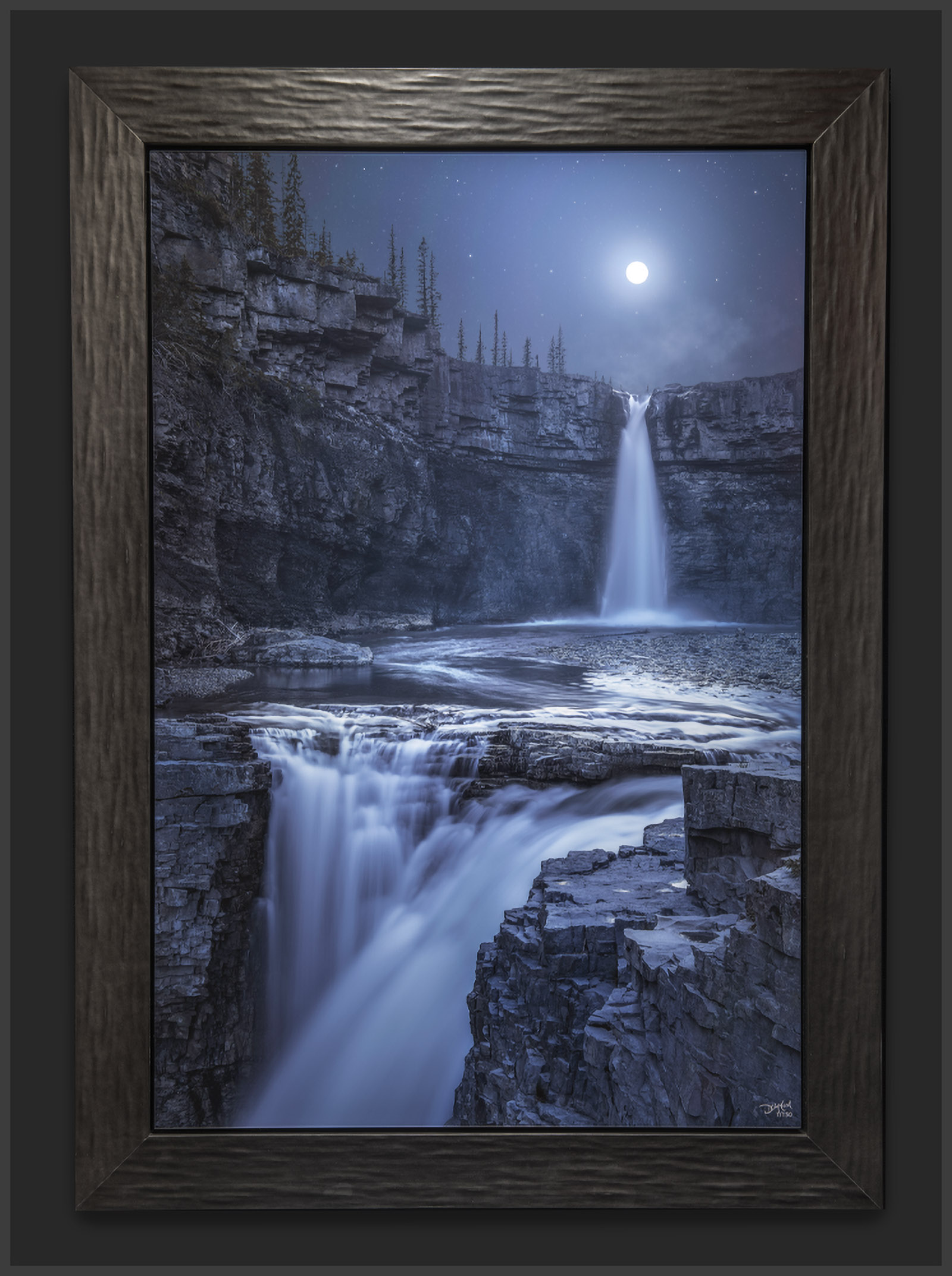 Lumachrome acrylic face-mount print of a waterfall image framed with a Roma Lavo Matte Charcoal wooden frame.